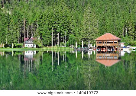 DOBBIACO ITALY - JULY 12: View of Dobbiaco lake in Veneto Italy on July 12 2014. Dobbiaco is a famous lake in Dolomites province Veneto Italy.