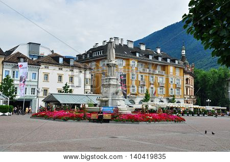 BOLZANO ITALY - JULY 20: View of a town square of Bolzano Italy on July 20 2014. Bolzano is a city in northern Italy one of two capitals of Trentino Alto province.