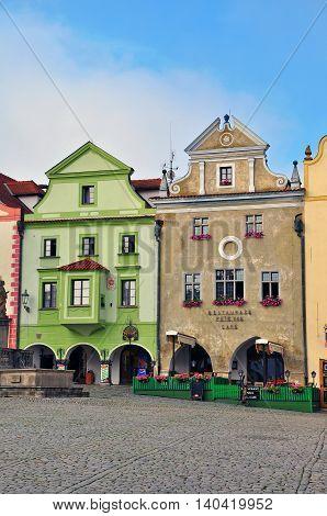 CESKY KRUMLOV CZECH REPUBLIC - AUGUST 1: Houses on a main square of Cesky Krumlov city centre on August 1 2014. Cesky Krumlov is a small city in the South Bohemian Region of the Czech Republic.