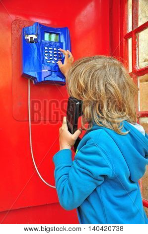 The Boy in the red telephone box