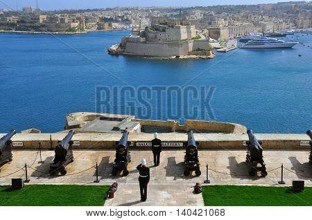VALLETTA MALTA - FEBRUARY 19: Start of saluting Lascaris Battery in Valletta city on February 19 2014. Valletta is a capital and the largest city of Malta.