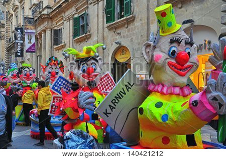 VALLETTA MALTA - FEBRUARY 28: Spring carnival on street of Valletta downtown on february 28 2014. Maltese carnival holds from february 27 till march 3 2014.