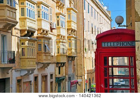 VALLETTA MALTA - FEBRUARY 19: Classic Telephone box in british style on the street of Valletta on February 19 2014. Valletta is a capital and the largest city of Malta.