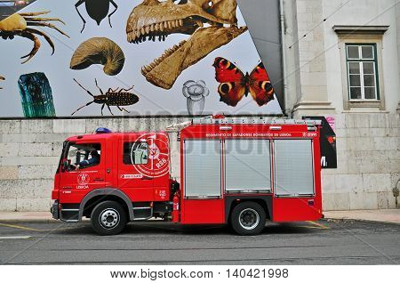 LISBON PORTUGAL - NOVEMBER 23: Fire truck of the fire department of portuguese Bombeiros on November 23 2012. A fire apparatus is a vehicle designed to assist in firefighting and other rescue operations.