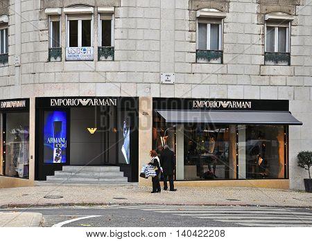 LISBON PORTUGAL - DECEMBER 11: Emporio Armani boutique on Avenida de Liberdad in Lisbon on November 24 2013. Avenida de Liberdad is one the most famous and popular shopping streets of Lisbon.
