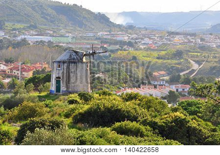 Landscape with old windmill in Obidos, Portugal