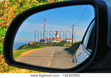 Lighthouse in the car mirror Cabo da Roca Portugal