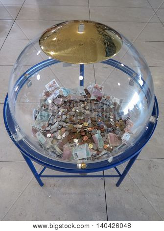 Charity piggy bank bowl useful for donations