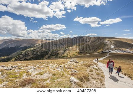 Grand Lake, USA - September 11, 2015: Alpine ridge trail to high peak in Rocky Mountains in Colorado with people hiking