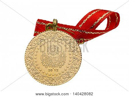 Front of whole Turkish gold coin with ribbon isolated on white background.