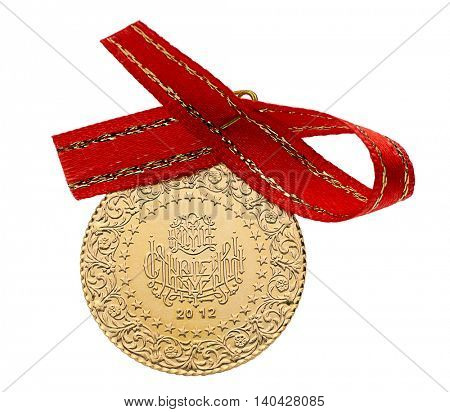 Whole Turkish gold coin with ribbon isolated on white background. (Back)