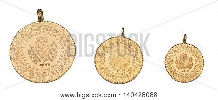 Whole, half and quarter Turkish gold coins isolated on white background.
