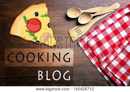 Checkered napkin and cutlery on wooden background. Cooking blog concept