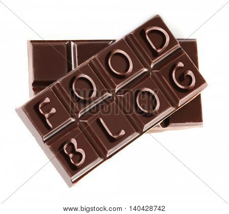 Black chocolate pieces isolated on white background. Food blog concept
