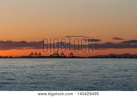 Sun dawn over the cranes from Point Roberts Washington State USA