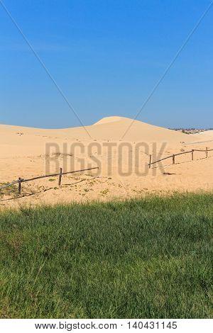 white sand dune and blue sky in mui ne vietnam