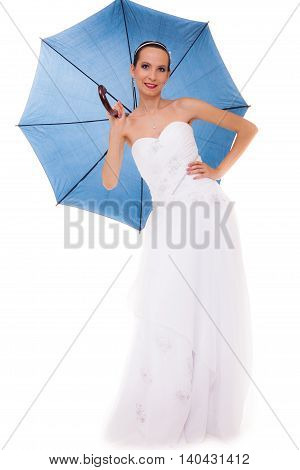 Wedding day at a raining day. Full length romantic bride white gown holding blue umbrella isolated on white