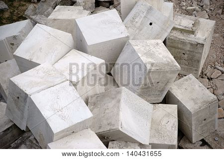 A pile piled and being cutted cubic concrete blocks.