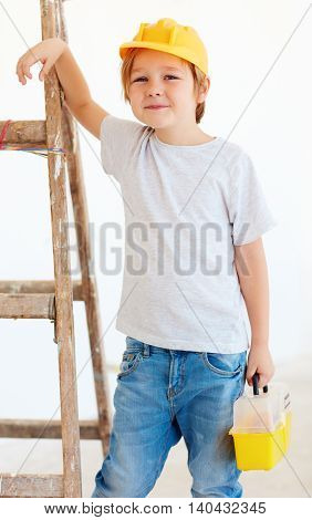 Cute Young Boy, Foreman Standing Near The Ladder