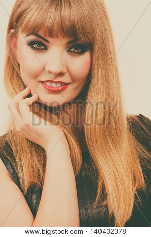 Woman elegant blonde lady dark makeup red lips portrait. People and glamour concept