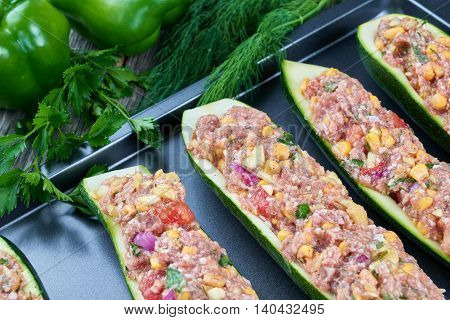 Raw courgettes stuffed with meat and vegetables