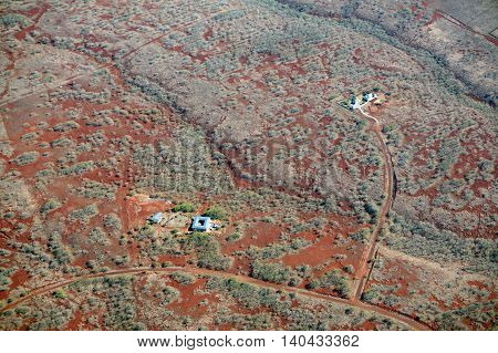 Aerial of Northwest counrtyside of Molokai with homes along dirt roads largely undeveloped with trees and bushes. April 2016.