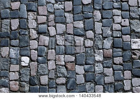 The background of granite paving in Prague