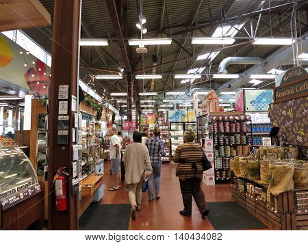 HONOLULU - DECEMBER 2: People explore Inside Kahala Whole Food Market filled with food and other consumer goods. Whole Foods is an American foods supermarket chain specializing in natural and organic foods. Honolulu Hawaii on December 2 2015.