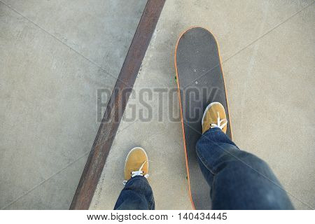 closeup of one skateboarder skateboarding at skatepark