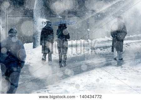 people walking on snow covered street
