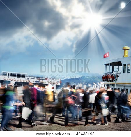 Blurry people walking to ferry boat in istanbul