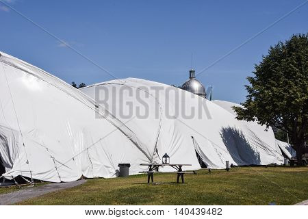 Dome is behind a large multi-section tent