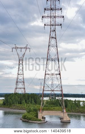 Large power towers run over a river