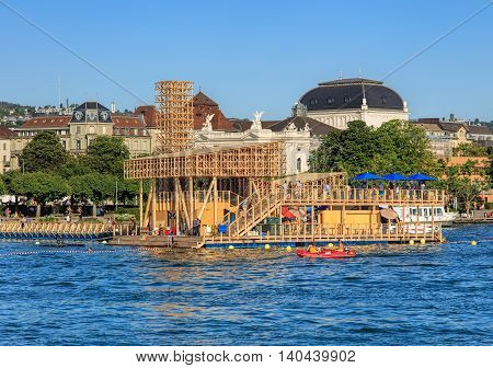Zurich, Switzerland - 20 July, 2016: Pavilion of Reflections on Lake Zurich, Zurich Opera House building in the background. The Pavilion of Reflections is a floating island with an open-air cinema and swimming pool.