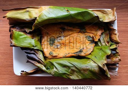 Fish curry in babana leaves in thailand