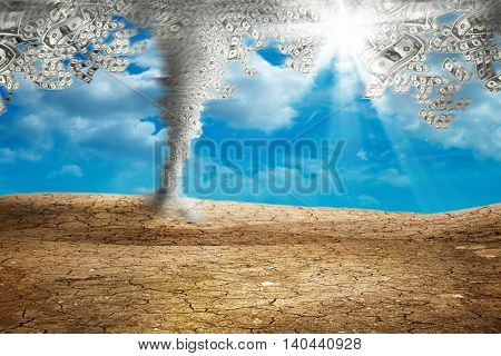 conceptual image of money storm on dried cracked landscape