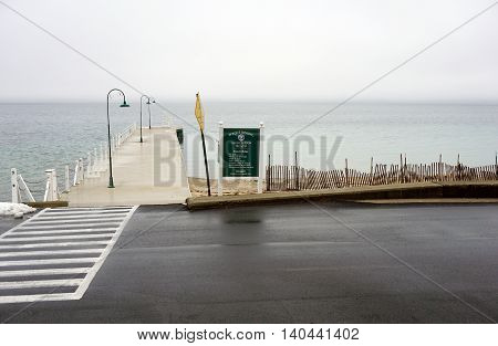 WEQUETONSING, MICHIGAN / UNITED STATES - DECEMBER 22, 2015: A sign provides the beach rules of the Wequetonsing Association Beach.