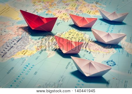 Paper Boats Following A Red Leader Boat