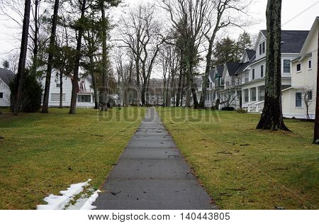 WEQUETONSING, MICHIGAN / UNITED STATES - DECEMBER 22, 2015: A sidewalk leads to homes from the beach in Wequetonsing, Michigan.