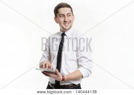 Man in a white shirt, a successful businessman holding a tablet in his hands and looking at the result.