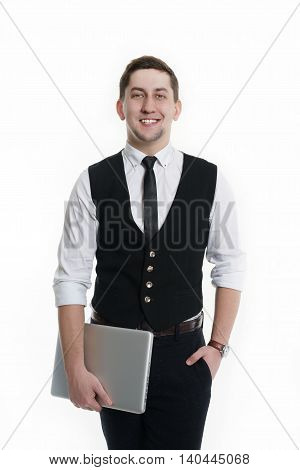 Portrait of a successful man in suit with laptop in his hands. Isolated on white background.