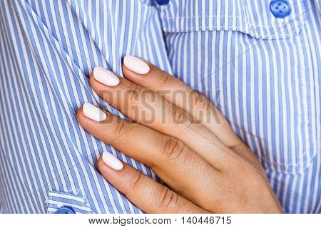 Woman In A Blue Shirt And Pink Manicure.