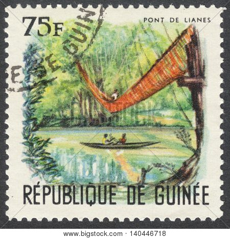MOSCOW RUSSIA - CIRCA APRIL 2016: a post stamp printed in GUINEA shows a local scenery the series