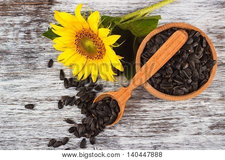 Sunflowers And Bowl With Sunflower Seeds