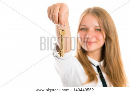 Beautiful smiling young woman with keys from an apartment or house in the hands. Photo on a white background