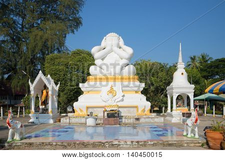 CHA-AM, THAILAND - JANUARY 04, 2014: View of the six-armed statue Buddha in the temple Wat Naranarayan. Religious landmark  of the city Cha Am, Thailand