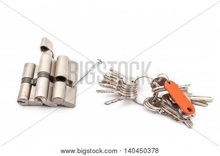 three different cylinders on white with screws and keys