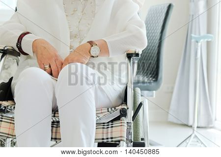 image of elderly woman in wheelchair background