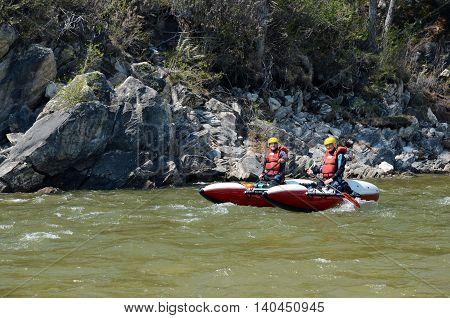 Rafting team float down the Irkut river. Buryatia, Sayan foothills