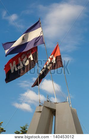 Leon Nicaragua - December 14 2015: FSLN sandinista and national flags General travel imagery for Nicaragua